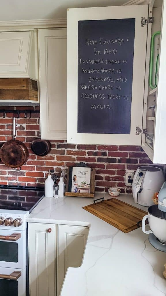 Use this DIY kitchen cabinet chalkboard tutorial idea to create a space for daily inspiration, functional reminders, or family messages.